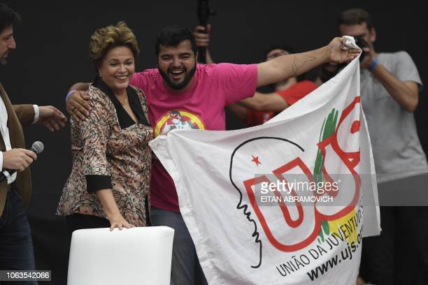 Former Brazilian president Dilma Rousseff greets a supporter during the First World Critical Thinking Forum in Buenos Aires on November 19 2018 The...