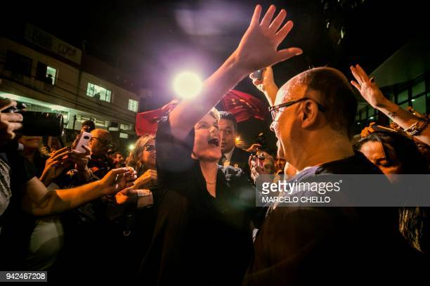 Former Brazilian president Dilma Rousseff waves to supporters of former president Luiz Inacio Lula da Silva outside the Metallurgical Union in Sao...