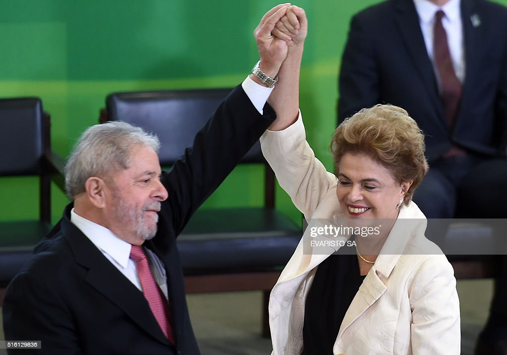 Former Brazilian president Luiz Inacio Lula da Silva (L) and Brazilian president Dilma Rousseff gesture during Lula's swear in ceremony as chief of staff, in Brasilia on March 17, 2016. Rousseff appointed Luiz Inacio Lula da Silva as her chief of staff hoping that his political prowess can save her administration. The president is battling an impeachment attempt, a deep recession, and the fallout of an explosive corruption scandal at state oil giant Petrobras.