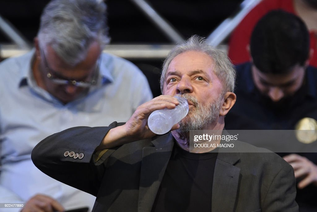 Former Brazilian president Luiz Inacio Lula da Silva drinks water during the launch of his pre-candidacy for the presidency, at the Expominas in Belo Horizonte, capital of Minas Gerais, Brazil, on ...