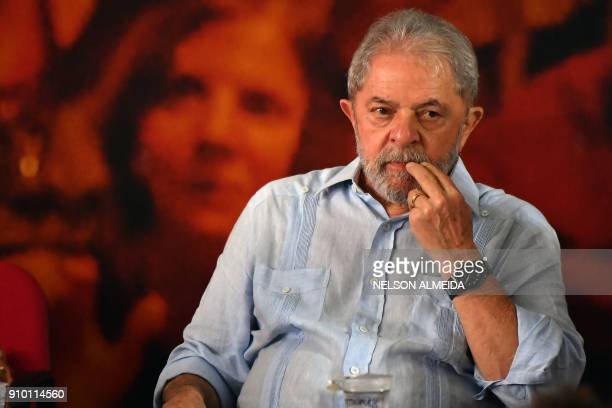 TOPSHOT Former Brazilian president Luiz Inacio Lula da Silva gestures during a campaign rally to launch his presidential candidacy for the upcoming...