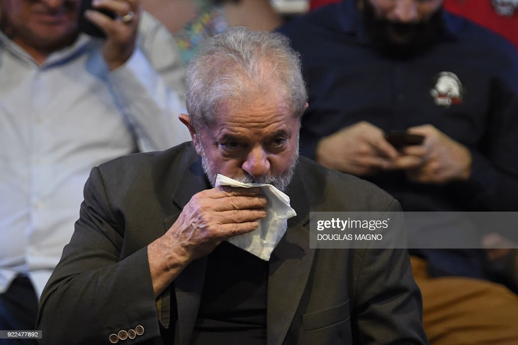 Former Brazilian president Luiz Inacio Lula da Silva gestures during the launch of his pre-candidacy for the presidency, at the Expominas in Belo Horizonte, capital of Minas Gerais, Brazil, on February 21, 2018. The capital of Minas Gerais is the first to host an event of this kind since Lula's conviction for corruption was upheld by a federal appeals court. /