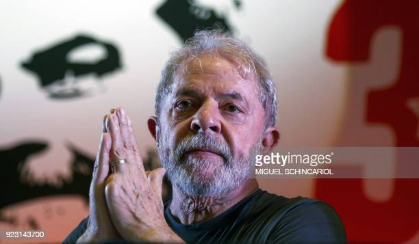 TOPSHOT Former Brazilian president Luiz Inacio Lula da Silva gestures during the commemoration of the 38th anniversary of the Workers Party in Sao...