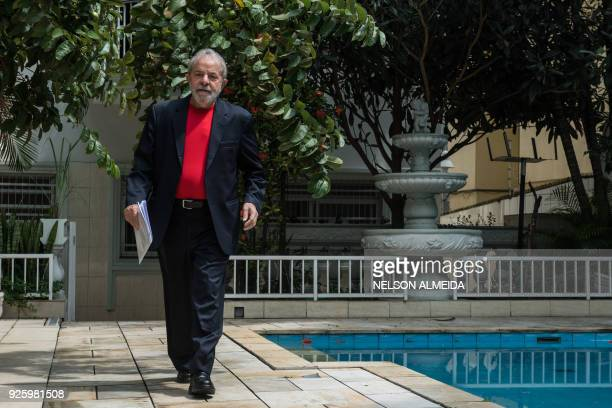 Former Brazilian president Luiz Inacio Lula da Silva gestures during an interview with AFP at Lula's Institute in Sao Paulo Brazil on March 1 2018 /...