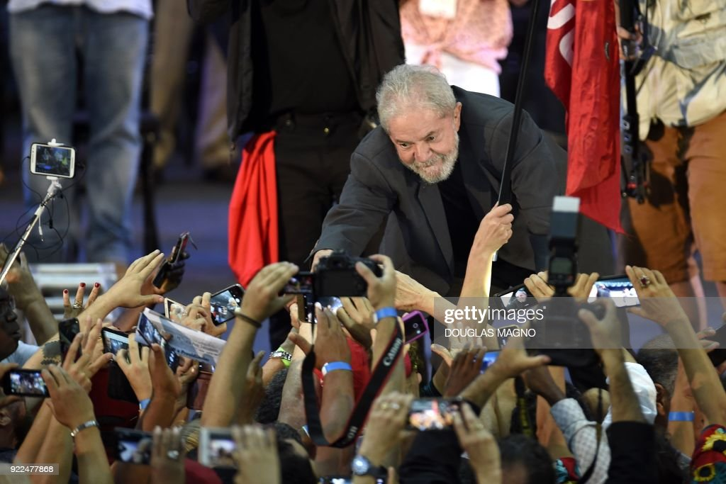 Former Brazilian president Luiz Inacio Lula da Silva greets supporters during the launch of his pre-candidacy for the presidency, at the Expominas in Belo Horizonte, capital of Minas Gerais, Brazil, on February 21, 2018. The capital of Minas Gerais is the first to host an event of this kind since Lula's conviction for corruption was upheld by a federal appeals court. /