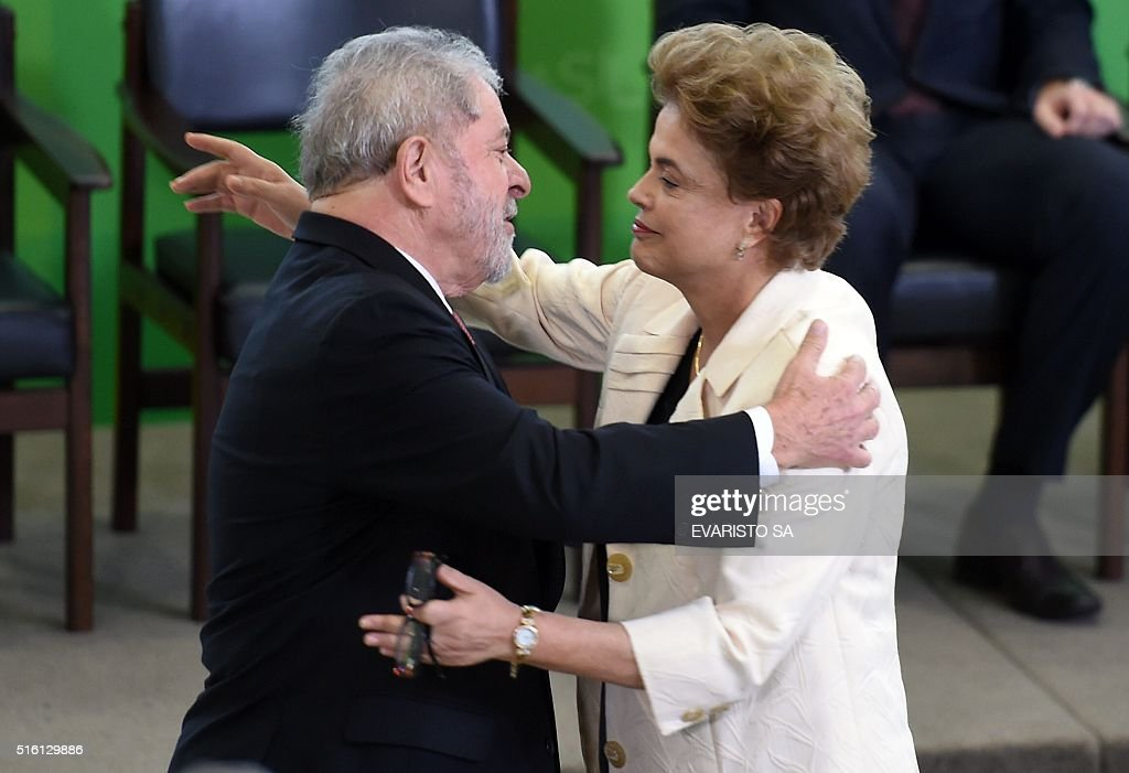 Former Brazilian president Luiz Inacio Lula da Silva (L) hugs Brazilian president Dilma Rousseff during Lula's swear in ceremony as chief of staff, in Brasilia on March 17, 2016. Rousseff appointed Luiz Inacio Lula da Silva as her chief of staff hoping that his political prowess can save her administration. The president is battling an impeachment attempt, a deep recession, and the fallout of an explosive corruption scandal at state oil giant Petrobras.