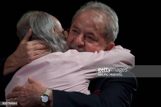 Former Brazilian president Luiz Inacio Lula da Silva hugs Brazilian actor Osmar Prado during a meeting with intellectuals at Oi Casa Grande Theater...