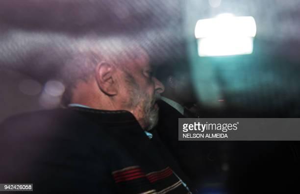 TOPSHOT Former Brazilian President Luiz Inacio Lula da Silva leaves Lula's Institute in Sao Paulo Brazil on April 4 2018 A Brazilian judge on...