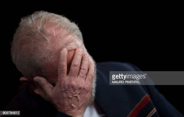 TOPSHOT Former Brazilian president Luiz Inacio Lula da Silva reacts during a meeting with intellectuals at Oi Casa Grande Theater in Rio de Janeiro...