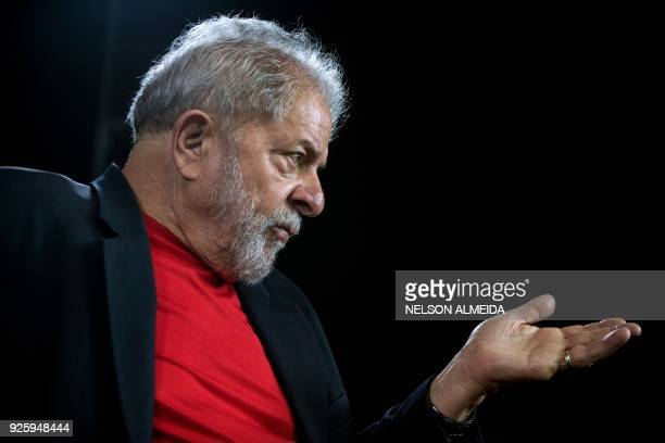 Former Brazilian president Luiz Inacio Lula da Silva speaks during an interview with AFP at Lula's Institute in Sao Paulo Brazil on March 1 2018 /...