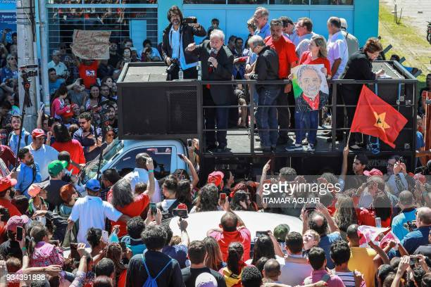 Former Brazilian President Luiz Inacio Lula da Silva speaks to the crowd during a political gathering in Bage south of Brazil on March 19 just a few...