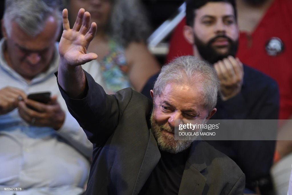 Former Brazilian president Luiz Inacio Lula da Silva waves during the launch of his pre-candidacy for the presidency, at the Expominas in Belo Horizonte, capital of Minas Gerais, Brazil, on Februar...