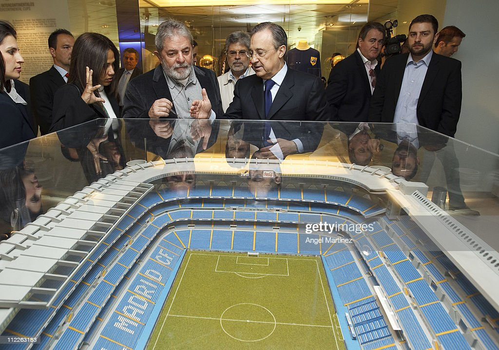 Former Brazilian President Lula da Silva (L) chats with President Florentino Perez of Real Madrid during a visit to the Estadio Santiago Bernabeu on April 16, 2011 in Madrid, Spain.