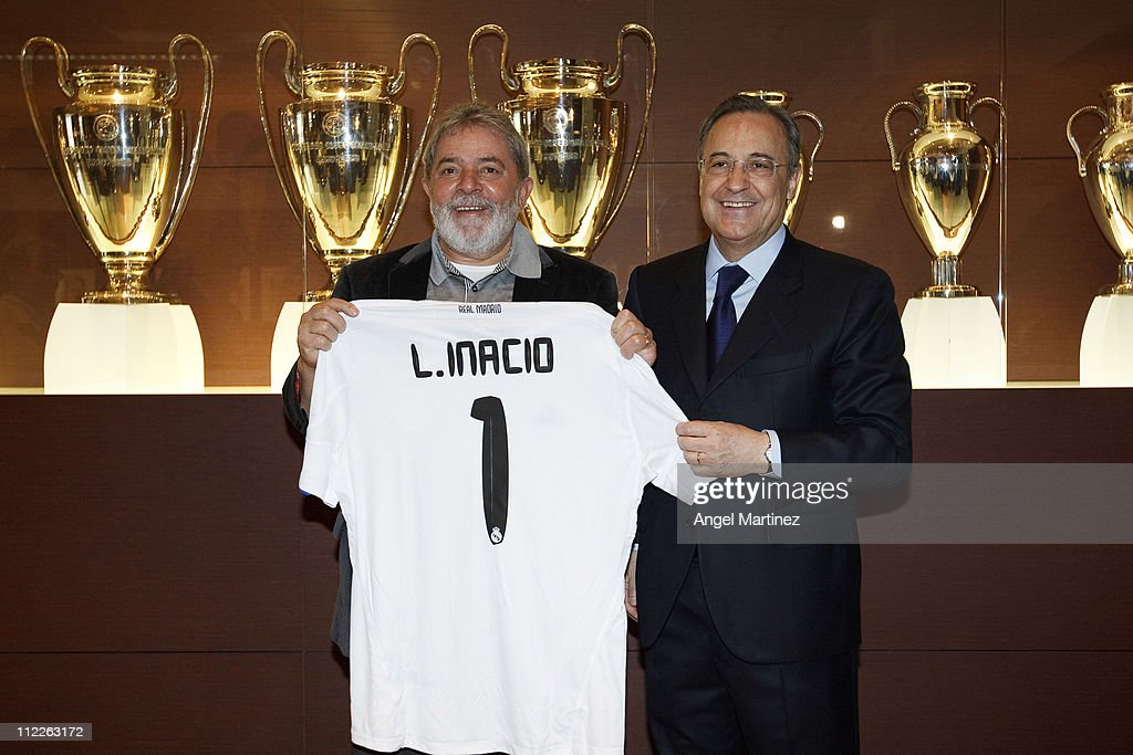 Former Brazilian President Lula da Silva (L) poses with President Florentino Perez of Real Madrid during a visit to the Estadio Santiago Bernabeu on April 16, 2011 in Madrid, Spain.