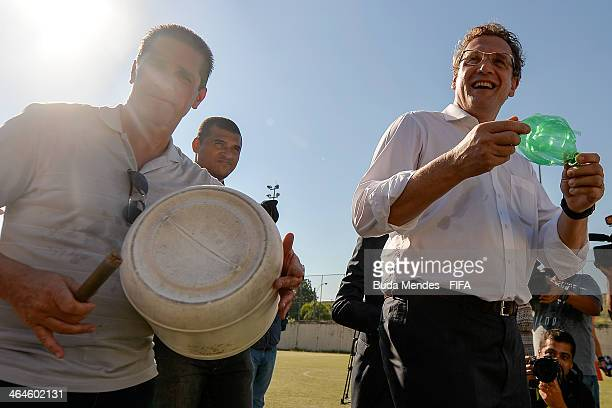 Former Brazilian soccer player and founder of the project Jorginho and FIFA Secretary General Jerome Valcke play instruments made from recycled...