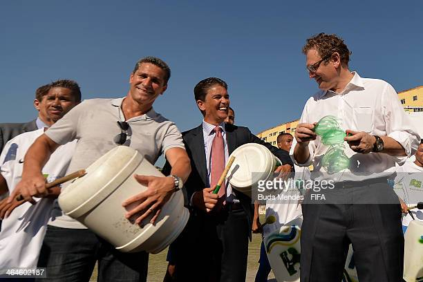 Former Brazilian soccer player and founder of the project Jorginho LOC Member Bebeto and FIFA Secretary General Jerome Valckeplay instruments made...