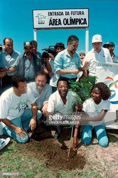 Former Brazilian soccer star and Sports Minister Edson Arantes do Nascimento known as Pelé plants a tree during a ceremony in Rio de Janeiro on...