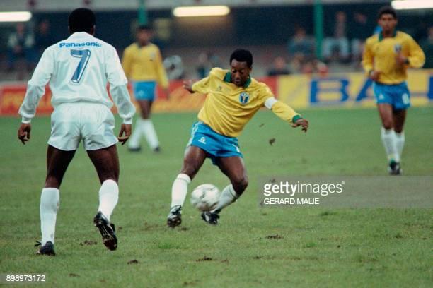 Former Brazilian soccer star Edson Arantes do Nascimento known as Pelé plays the ball during a friendly soccer match opposing Brazil to world soccer...