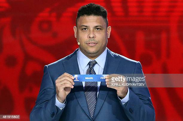 Former Brazilian striker Ronaldo shows the name of Brazil during the preliminary draw for the South American Football Confederation zone for the 2018...
