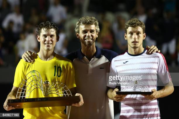 Former Brazilian tennis player Gustavo 'Guga' Kuerten poses for pictures next to Dominic Thiem of Austria and Pablo Carreno Busta of Spain after...