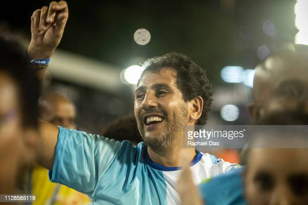 Former Brazilian volleyball player Mauricio Lima dances during Beija Flor performance at the Rio de Janeiro Carnival at Sambodromo on March 3 2019 in...