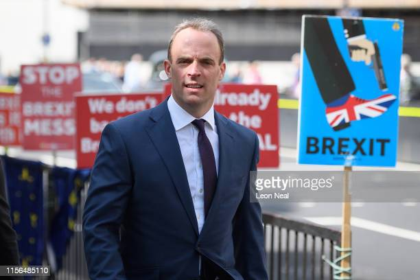 Former Brexit Secretary Dominic Raab passes antiBrexit posters as he walks through Westminster on June 17 2019 in London England Raab is currently...