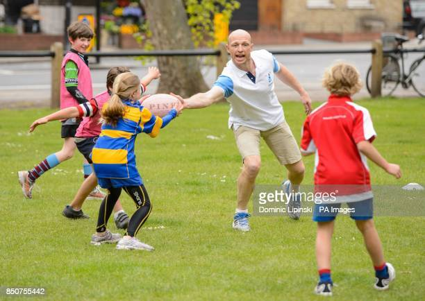 Former British and Irish Lions player Matt Dawson takes part in a rugby coaching session during a photocall at the Pink Lion pub in Parsons Green...