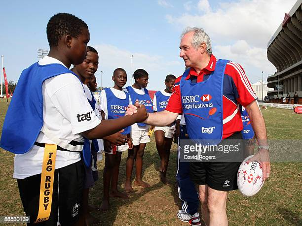 Former British and Irish Lions scrumhalf Gareth Edwards meets local children during the HSBC Durban Rugby Coaching Festival at Kings Park on June 17...