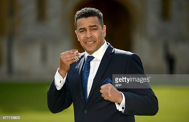 Former British boxer Quinton Shillingford poses for photographs after being made a Member of the Order of the British Empire for services to Boxing...