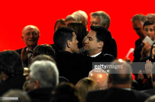 Former British climate change minister Ed Miliband embraces his brother, the former Foreign Secretary David Miliband, after being elected new leader...