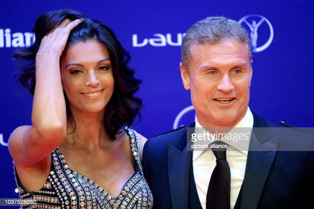 Former British driver and girlfriend Karen Minier arrive at the Laureus Sport Awards in Berlin Germany 18 April 2016 This is the 17th time the awards...