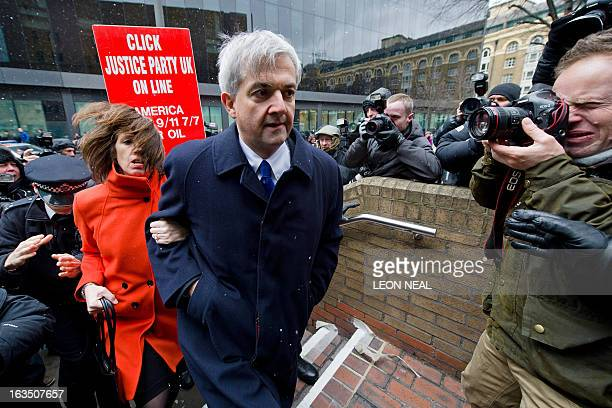 Former British energy minister Chris Huhne and his partner Carina Trimingham arrive at Southwark Crown Court in London on March 11 2013 Huhne and his...