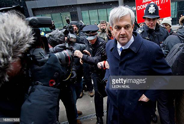 Former British energy minister Chris Huhne arrives at Southwark Crown Court in London on March 11 2013 Huhne and his exwife Vicky Pryce are due to be...