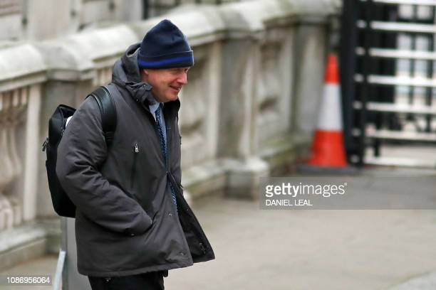 Former British Foreign Secretary Boris Johnson walks across Downing Street in London on January 23 2019 ahead of the weekly Prime Minister's...