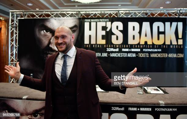 Former British heavyweight world boxing champion Tyson Fury gestures during a press conference to announce his comeback in central London on April 12...