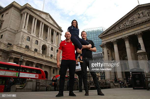 Former British Irish Lion Lawrence Dallaglio and former New Zealand All Black Ali Williams lift soprano Laura Wright during a media event to announce...