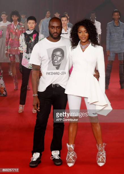 Former British model Naomi Campbell and fashion designer for Off White Virgil Abloh acknowledge the public at the end of the Off White women's 2018...