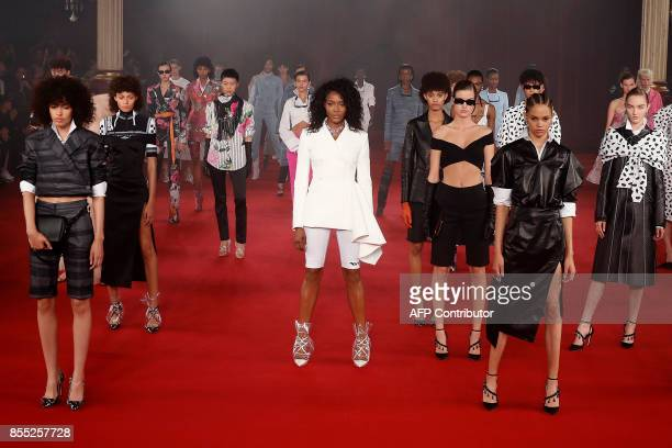 Former British model Naomi Campbell and models present creations by Off White during the women's 2018 Spring/Summer readytowear collection fashion...