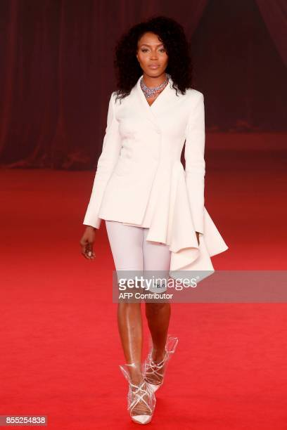 Former British model Naomi Campbell presents a creation by Off White during the women's 2018 Spring/Summer readytowear collection fashion show in...
