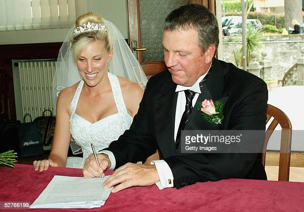 Former British Open Champion and Ryder Cup Player Mark Calcavecchia and his new wife Brenda pose at their wedding on May 5 2005 in Como Italy