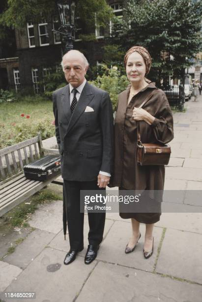 Former British politician John Profumo attends a memorial service for Sir Michael Redgrave at St Paul's Church in Covent Garden London with his wife...
