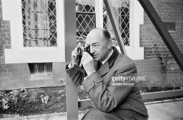 Former British politician John Profumo takes photographs at the opening of Attlee House 17th November 1971 Profumo proposed the building of the house...