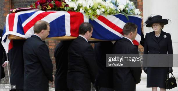 Former British Prime Minister Baroness Margaret Thatcher watches as the coffin of her husband Sir Denis is carried into the Royal Hospital Chapel...