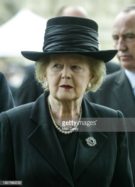 Former British Prime Minister Baroness Thatcher leaves after attending the funeral of former Conservative prime minister Sir Edward Heath at...