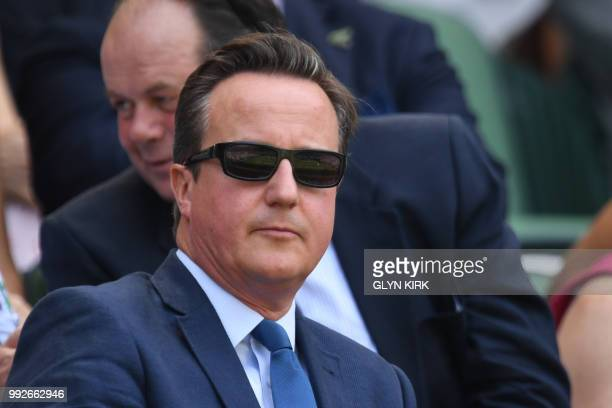 Former British Prime Minister David Cameron arrives on centre court to watch US player Sam Querrey play France's Gael Monfils in their men's singles...