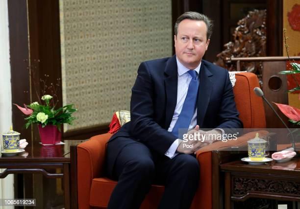 Former British Prime Minister David Cameron meets China's Premier Li Keqiang at Zhongnanhai leadership compound on November 27 2018 in Beijing China