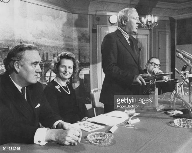 Former British Prime Minister Edward Heath introduces the new leader of the Conservative Party Margaret Thatcher as the main speaker at a meeting in...