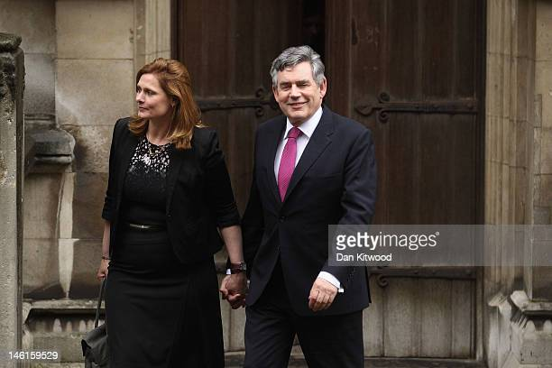 Former British Prime Minister Gordon Brown and his wife Sarah Brown leave after giving evidence at the Leveson Inquiry on June 11 2012 in London...