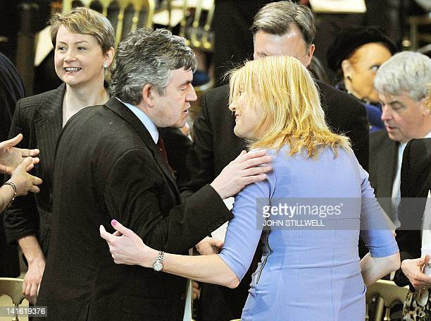 Former British prime minister Gordon Brown greets Sally Bercow wife of the speaker of the House of Commons John Bercow during a Loyal Address service...