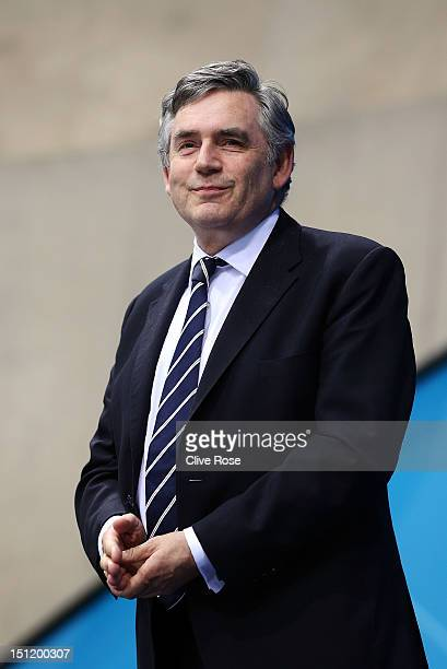 Former British Prime Minister Gordon Brown presents the medals for the Men's 50m Freestyle S8 final on day 5 of the London 2012 Paralympic Games at...